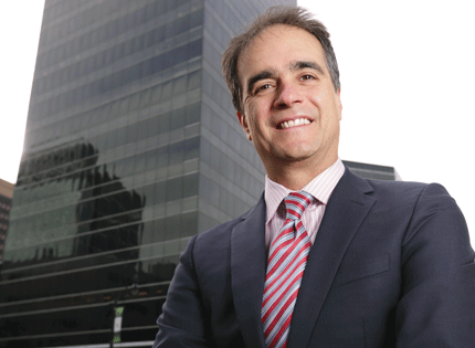 Maurice Ades, principal and managing partner of Rugby Realty, in front of Three Gateway Center in Newark.