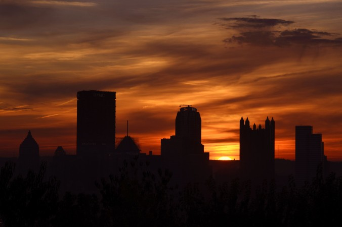 The sun begins to rise over the Pittsburgh skyline this morning. Pittsburgh is such a hot shot tech hub and is building such a reputation that some local officials and executives think it needs its own name.